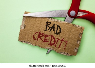 Text sign showing Bad Credit Question. Conceptual photo Low Credit Finance Economic Budget Asking Questionaire written on Tear Cardboard on the plain background with Scissor.