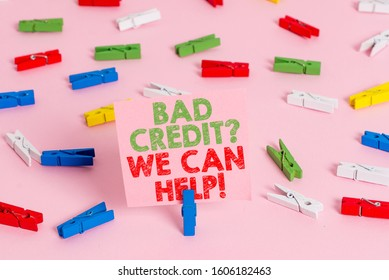 Text sign showing Bad Credit question We Can Help. Conceptual photo Borrower with high risk Debts Financial Colored clothespin papers empty reminder pink floor background office pin.