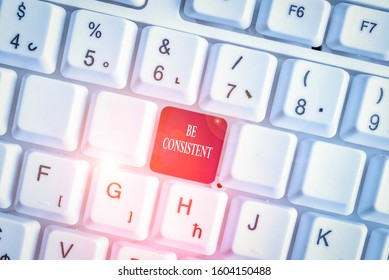 Text sign showing Be Consistent. Conceptual photo Uniform Persistent Firm Unalterable Even Unchanging Rapport White pc keyboard with empty note paper above white background key copy space.