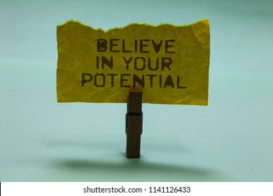 Text sign showing Believe In Your Potential. Conceptual photo Have self-confidence motiavate inspire yourself Paperclip hold torn yellow page written brown words sky blue background.