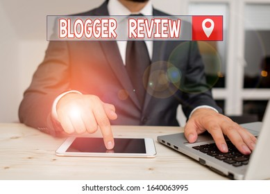 Text sign showing Blogger Review. Conceptual photo making a critical reconsideration and summary of a blog Male human wear formal clothes present presentation use hi tech smartphone.