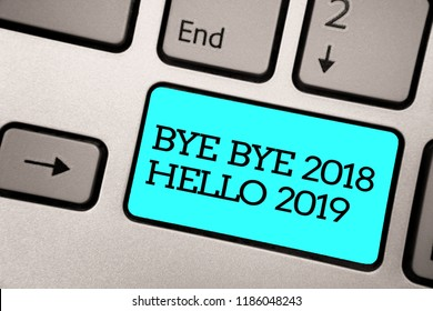 Text sign showing Bye Bye 2018 Hello 2019. Conceptual photo Starting new year Motivational message 2018 is over Silver grey computer keyboard with blue button black color written text.