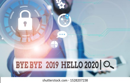 Text sign showing Bye Bye 2019 Hello 2020. Conceptual photo Starting new year Motivational message 2019 is over Male human wear formal work suit presenting presentation using smart device.
