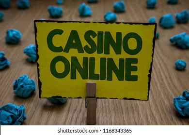 Text sign showing Casino Online. Conceptual photo Computer Poker Game Gamble Royal Bet Lotto High Stakes Clothespin holding yellow paper note crumpled papers several tries mistakes.