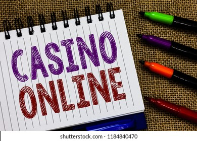 Text sign showing Casino Online. Conceptual photo Computer Poker Game Gamble Royal Bet Lotto High Stakes Open spiral notebook page jute background colorful markers Expressing ideas.