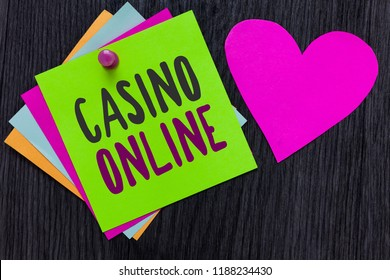 Text sign showing Casino Online. Conceptual photo Computer Poker Game Gamble Royal Bet Lotto High Stakes Papers Romantic lovely message Heart Good feelings Wooden background.