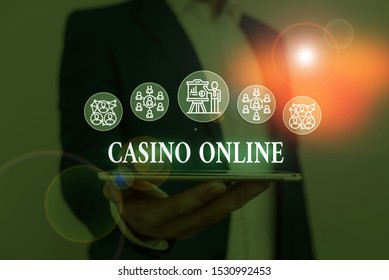 Text sign showing Casino Online. Conceptual photo Computer Poker Game Gamble Royal Bet Lotto High Stakes Male human wear formal work suit presenting presentation using smart device.