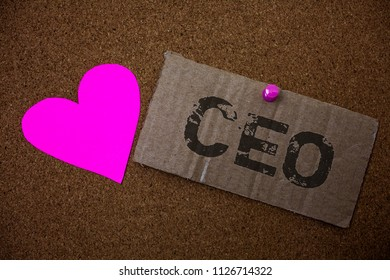 Text sign showing Ceo. Conceptual photo Chief Executive Officer Head Boss Chairperson Chairman Controller Old damaged paperboard ideas message purple heart love lovely intentions.