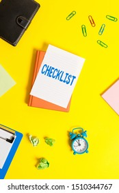 Text sign showing Checklist. Conceptual photo List down of the detailed activity as guide of doing something Pile of empty papers with copy space on the table.