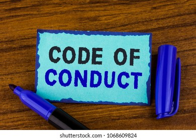 Text sign showing Code Of Conduct. Conceptual photo Follow principles and standards for business integrity written Sticky Note paper the wooden background Marker next to it.