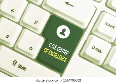 Text sign showing Coe Center Of Excellence. Conceptual photo being alpha leader in your position Achieve White pc keyboard with empty note paper above white background key copy space.