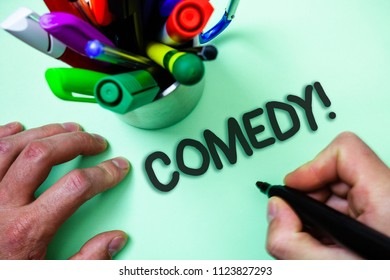 Text sign showing Comedy Call. Conceptual photo Fun Humor Satire Sitcom Hilarity Joking Entertainment Laughing Man holding black marker white background markers intention communicate.