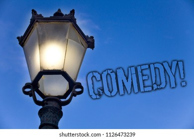 Text sign showing Comedy Call. Conceptual photo Fun Humor Satire Sitcom Hilarity Joking Entertainment Laughing Light post blue sky enlighten ideas message old vintage antique Victorian.