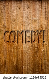 Text sign showing Comedy Call. Conceptual photo Fun Humor Satire Sitcom Hilarity Joking Entertainment Laughing Ideas messages wooden background intentions feelings thoughts communicate.