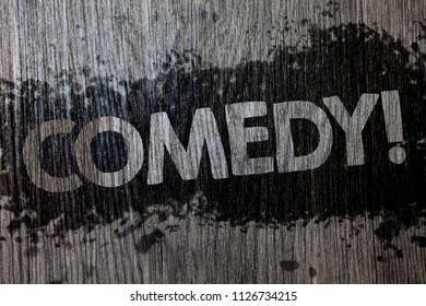 Text sign showing Comedy Call. Conceptual photo Fun Humor Satire Sitcom Hilarity Joking Entertainment Laughing Wooden wood background black splatter paint ideas messages intentions.