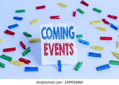 Text sign showing Coming Events. Conceptual photo Happening soon Forthcoming Planned meet Upcoming In the Future Colored clothespin papers empty reminder white floor background office.