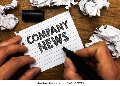 Text sign showing Company News. Conceptual photo Latest Information and happening on a business Corporate Report Man holding marker notebook page crumpled papers several tries mistakes.