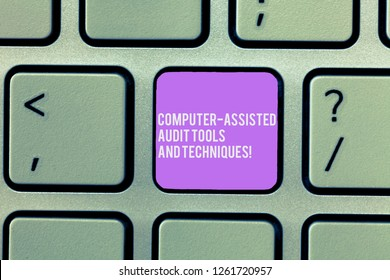 Text sign showing Computer Assisted Audit Tools And Techniques. Conceptual photo Modern auditing applications Keyboard key Intention to create computer message, pressing keypad idea.