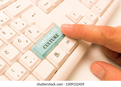 Text sign showing Corporate Culture. Conceptual photo pervasive values and attitudes that characterize a company White pc keyboard with empty note paper above white background key copy space.