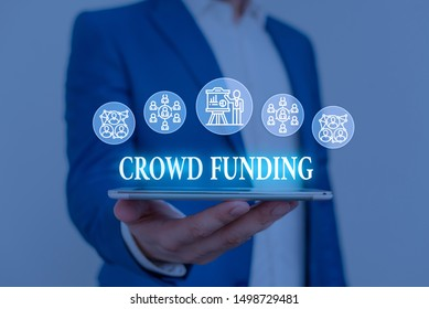 Text sign showing Crowd Funding. Conceptual photo Fundraising Kickstarter Startup Pledge Platform Donations Male human wear formal work suit presenting presentation using smart device.