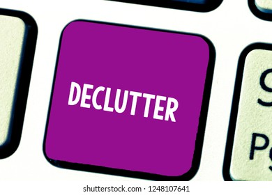 Text sign showing Declutter. Conceptual photo remove unnecessary items from untidy or overcrowded place Keyboard key Intention to create computer message, pressing keypad idea.