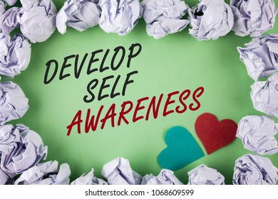 Text sign showing Develop Self Awareness. Conceptual photo What you think you become motivate and grow written plain green background within White Paper Balls Hearts next to it.