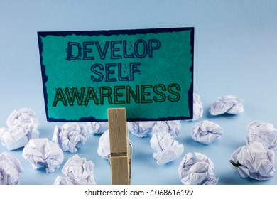 Text sign showing Develop Self Awareness. Conceptual photo What you think you become motivate and grow written Sticky Note Paper holding by Clip plain background White Paper Balls
