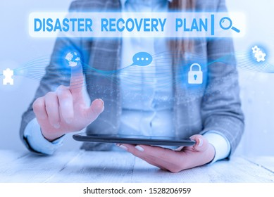 Text sign showing Disaster Recovery Plan. Conceptual photo having backup measures against dangerous situation Female human wear formal work suit presenting presentation use smart device.