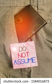 Text sign showing Do Not Assume. Conceptual photo Ask first to avoid misunderstandings confusion problems Small little wallet inside man trousers front pocket near notation paper.
