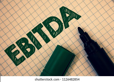Text sign showing Ebitda. Conceptual photo Earnings Before Interest Taxes Depreciation Amortization Abbreviation Squared paper open marker ideas messages inspirational thoughts feelings.