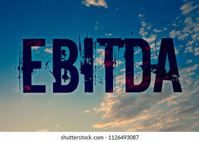 Text sign showing Ebitda. Conceptual photo Earnings Before Interest Taxes Depreciation Amortization Abbreviation Ideas messages blue clouds cloudy sky splatters natural motivational.