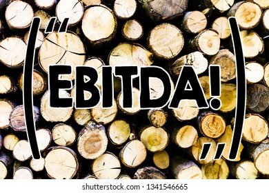 Text sign showing Ebitda. Conceptual photo Earnings Before Interest Taxes Depreciation Amortization Abbreviation Wooden background vintage wood wild message ideas intentions thoughts.