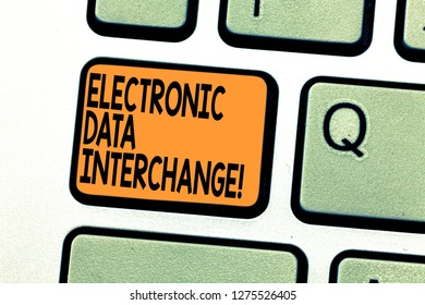 Text sign showing Electronic Data Interchange. Conceptual photo Transfer of data from one computer into another Keyboard key Intention to create computer message pressing keypad idea.
