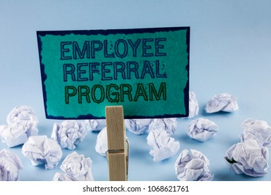Text sign showing Employee Referral Program. Conceptual photo Recommend right jobseeker share vacant job post written Sticky Note Paper holding by Clip plain background White Paper Balls