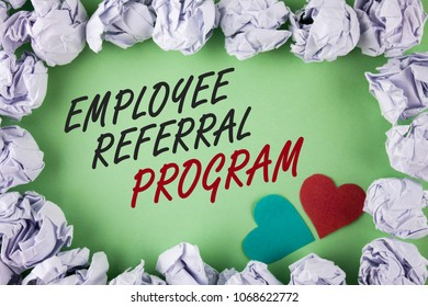 Text sign showing Employee Referral Program. Conceptual photo Recommend right jobseeker share vacant job post written plain green background within White Paper Balls Hearts next to it.