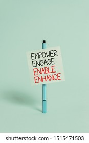 Text sign showing Empower Engage Enable Enhance. Conceptual photo Empowerment Leadership Motivation Engagement Ballpoint blank colored sticky note peaceful cool pastel fashion background.