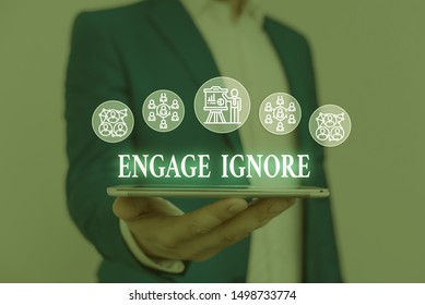Text sign showing Engage Ignore. Conceptual photo Silent Treatment Manipulative Punishment Sulking Shunning Male human wear formal work suit presenting presentation using smart device.