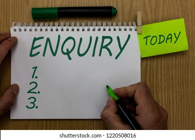 Text sign showing Enquiry. Conceptual photo Asking for information Official investigation discover facts Inquiry Man holding marker notebook clothespin reminder wooden table cup coffee.
