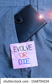 Text sign showing Evolve Or Die. Conceptual photo Necessity of change grow adapt to continue living Survival Small little wallet inside man trousers front pocket near notation paper.