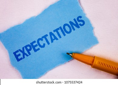 Text sign showing Expectations. Conceptual photo Huge sales in equity market assumptions by an expert analyst written on Tear Blue Sticky note paper on plain background Pen next to it.