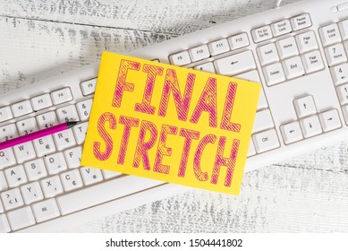 Text sign showing Final Stretch. Conceptual photo Last Leg Concluding Round Ultimate Stage Finale Year ender White keyboard office supplies empty rectangle shaped paper reminder wood.
