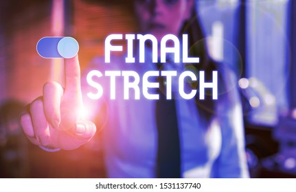 Text sign showing Final Stretch. Conceptual photo Last Leg Concluding Round Ultimate Stage Finale Year ender Blurred woman in the background pointing with finger in empty space.
