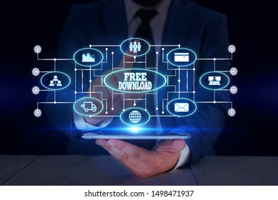 Text sign showing Free Download. Conceptual photo Key in Transfigure Initialize Freebies Wireless Images Male human wear formal work suit presenting presentation using smart device.