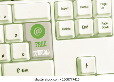 Text sign showing Free Download. Conceptual photo Key in Transfigure Initialize Freebies Wireless Images White pc keyboard with empty note paper above white background key copy space.