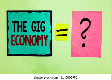 Text sign showing The Gig Economy. Conceptual photo Market of Short-term contracts freelance work temporary Black lined written note middle queal pink page black question mark.