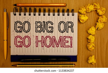 Text sign showing Go Big Or Go Home Motivational Call. Conceptual photo Mindset Ambitious Impulse Persistence Notepad with outline text pen pencil woody desk crimp balls form query mark.