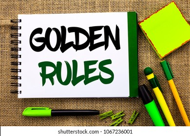 Text sign showing Golden Rules. Conceptual photo Regulation Principles Core Purpose Plan Norm Policy Statement written Notebooke Book the jute background Pens Clips Sticky Note next to it.