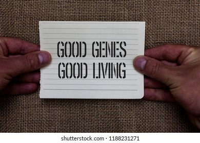 Text sign showing Good Genes Good Living. Conceptual photo Inherited Genetic results in Longevity Healthy Life Man holding piece notebook paper jute background Communicating ideas.