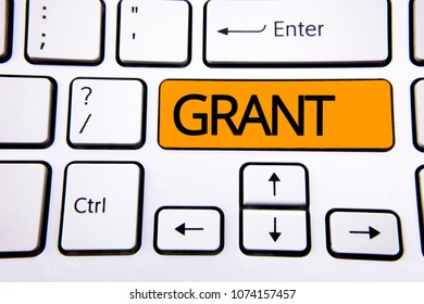 Text sign showing Grant. Conceptual photo Money given by an organization or government for a purpose Scholarship written on Orange Key Button on White Keyboard with copy space. Top view.