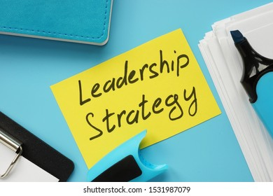 Text sign showing hand written words Leadership Strategy